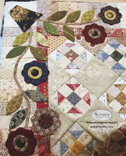 quilt with all provincial flowers appliqued on iton it